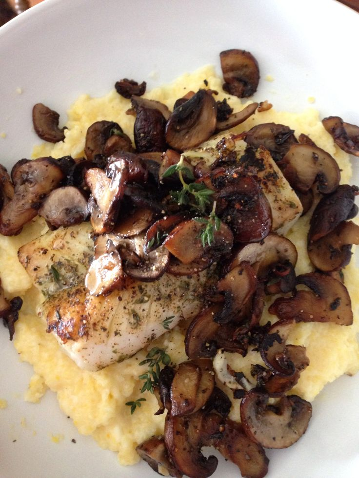 Creamy polenta with grilled cod and sautéed mushrooms.