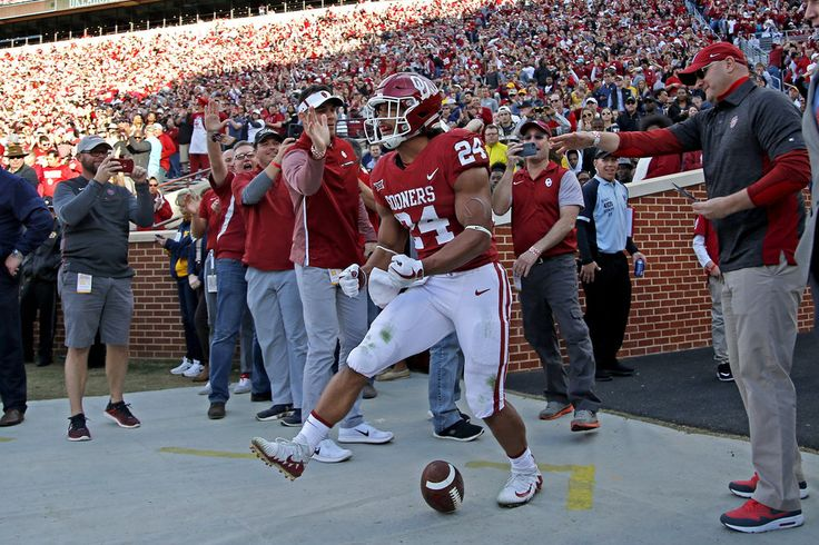 Oklahoma's Rodney Anderson (24) celebrates after scoring a touchdown during a college football game between the Oklahoma Sooners (OU) and the West Virginia Mountaineers at Gaylord Family-Oklahoma Memorial Stadium in Norman, Okla., Friday, Nov. 24, 2017. Oklahoma won 59-31. Photo by Bryan Terry, The Oklahoman