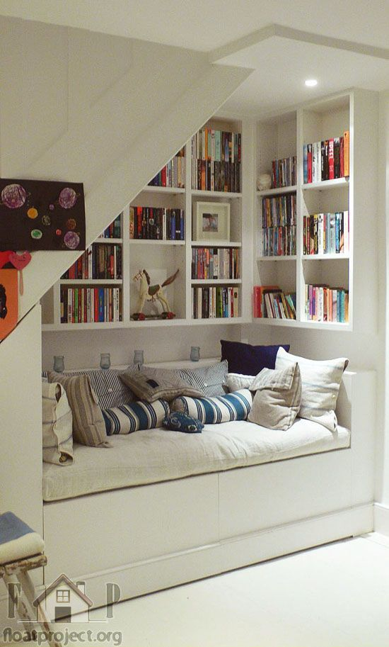 Perfect reading nook under the #stairs! #books #shelves #bookshelves #storage…