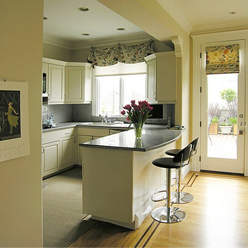 An over sink valance with a matching door roman shade spices up this Pacific Heights, San Francisco kitchen