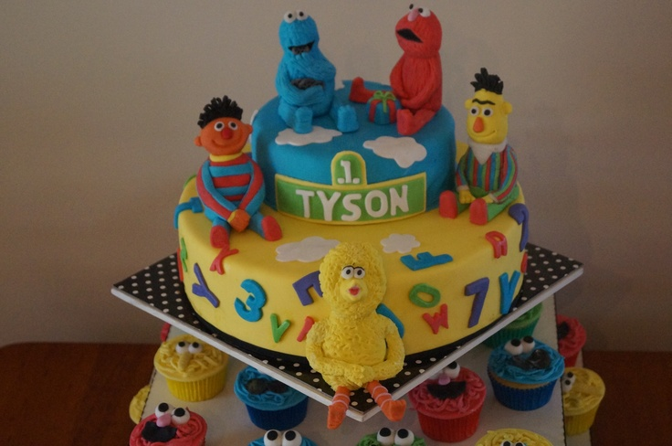 1st birthday cake using cupcake toppers and sesame street characters