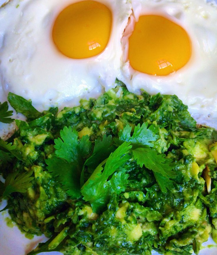 Simple but nutritious breakfast This cilantro-garlic guac is eggcellent   For guac~~ 1/2 avocado, 1 clove garlic, tsp lime juice, spinach, and cilantro  Cilantro = helps cleanse heavy metals and is rich in vitamins A, C, E, and K   #eattheyolk folks