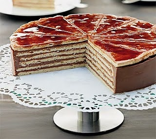 Dobos Torte- Hungarian dessert  Dobosh or Dobos Torte was first introduced at the National General Exhibition of Budapest in 1885; Franz Joseph I and his Empress Elisabeth were among the first to taste it. The cake soon became popular throughout Europe as it was different from all others. It was simple but elegant, as opposed to the multi-layer, flaming cakes of the age. Its other secret was its use of fine buttercream, which was very little known at the time.Recipe