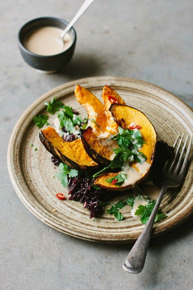 Roasted pumpkin with black rice and tangerine tahini sauce recipe