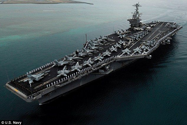 US aircraft carrier strike group patrols disputed South China Sea