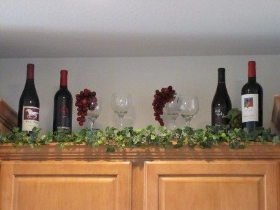 I could use my empty bottles to put up there what a great idea