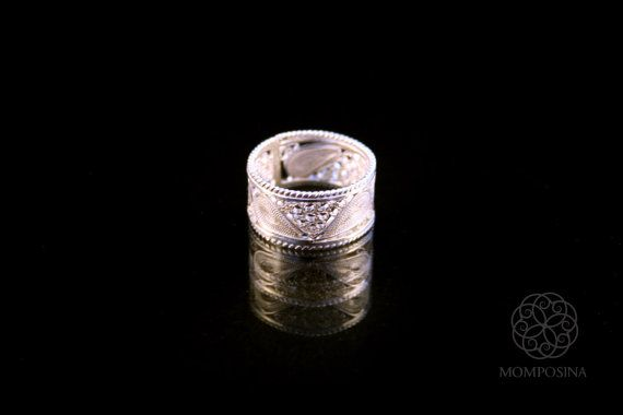 Woven silver filigree ring with traditional colonial style.