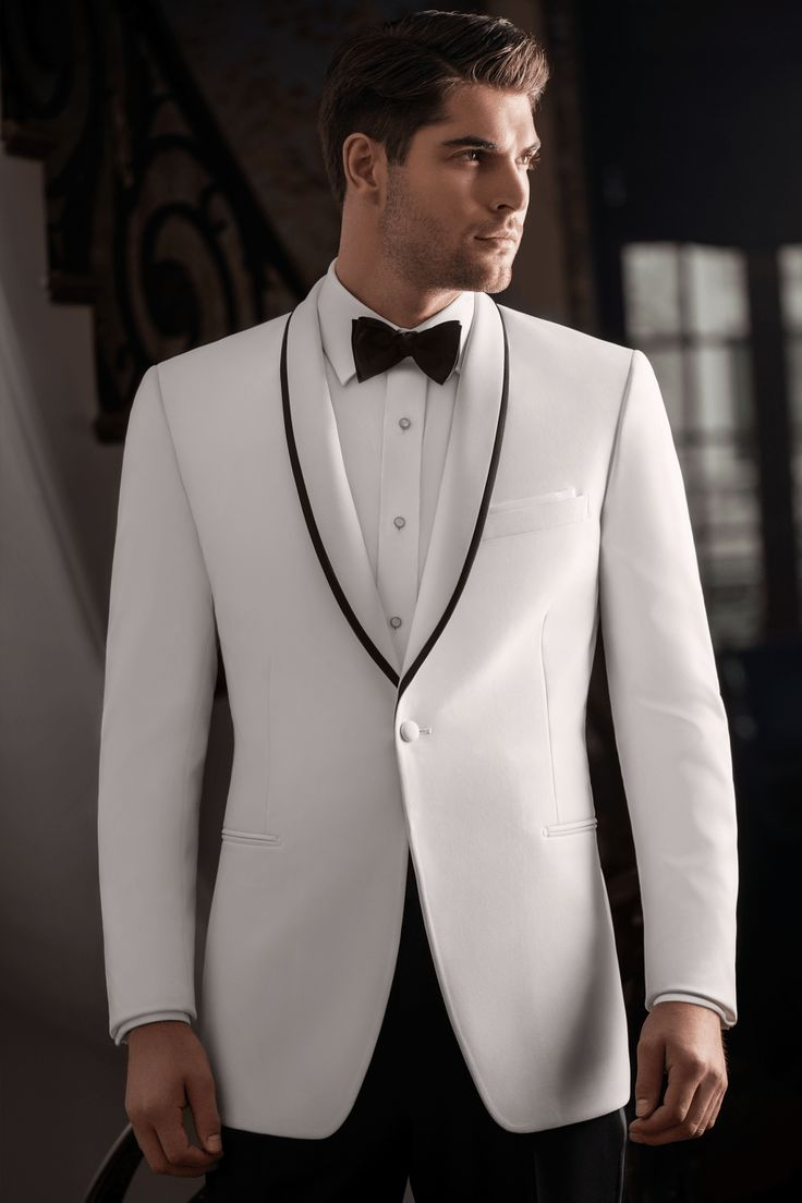 This classic white with black trim coat from Regal Tuxedo will make you fall in love with him all over again! Click the image to learn more. Photo credit: Regal Tuxedo webpage