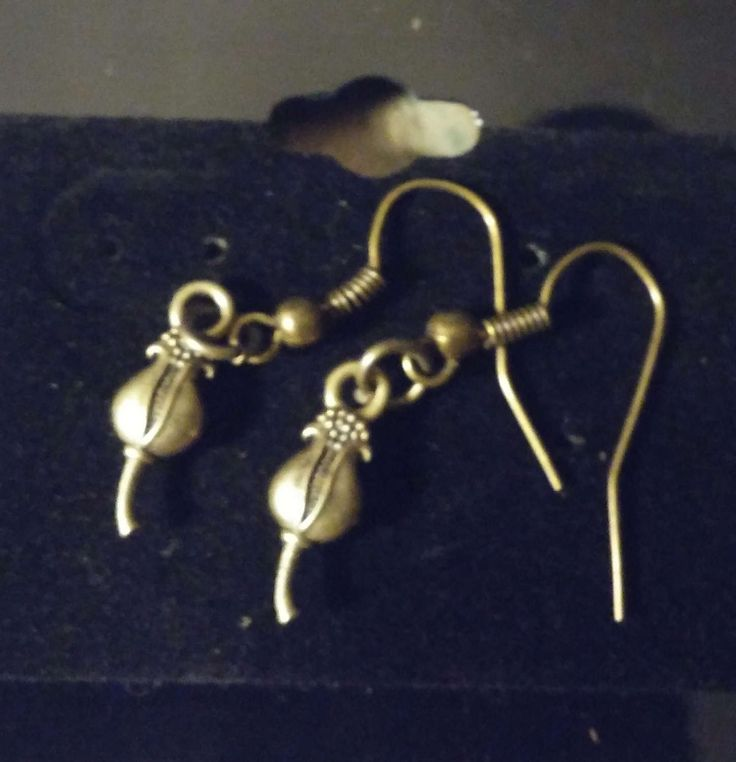 Bronze flower bud handmade earrings by SpryHandcrafted on Etsy