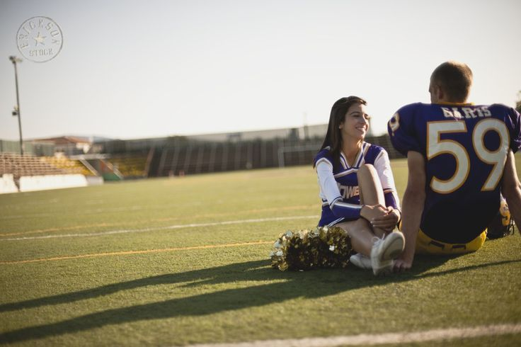 Swoony young couple, cheerleader and football player, gazing into each other's eyes. | Stock Photography | Erickson Stock
