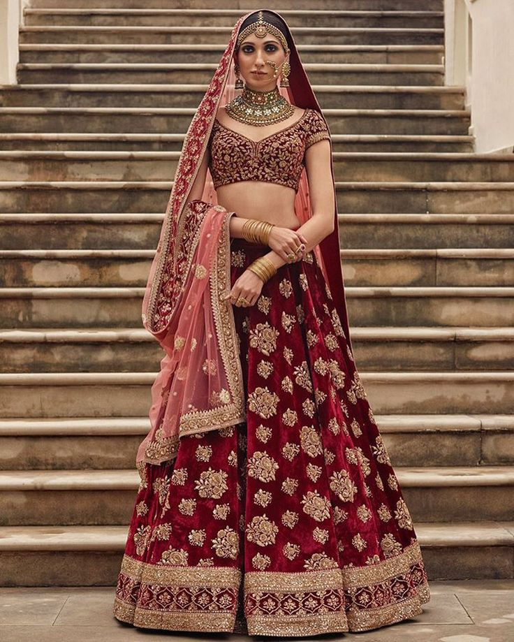Nobody does the contrast dupatta look better than Sabyasachi. The pale pink looks amazing with the maroon velvet lehenga set. #Frugal2Fab