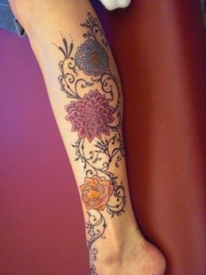 I would do stargazers, fire & ice roses & purple wisteria & continue down thigh conecting to my current tat!  I like the lace filigreed scroll work.