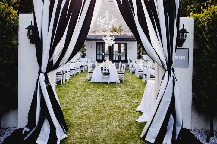 Black And White Striped Fabric Draping As An Entrance To