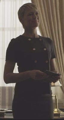 House of Cards Season 2 fashion: Click to find out who designed Claire Underwood's (Robin Wright) black, shirtsleeved double breasted jacket/cardigan #houseofcards #claireunderwood #getthelook