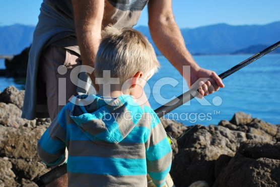 Father Teaches his Toddler to Fish royalty-free stock photo