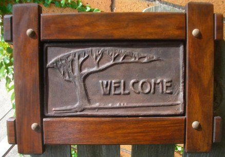 Welcome tile in sapele arts and crafts revival frame