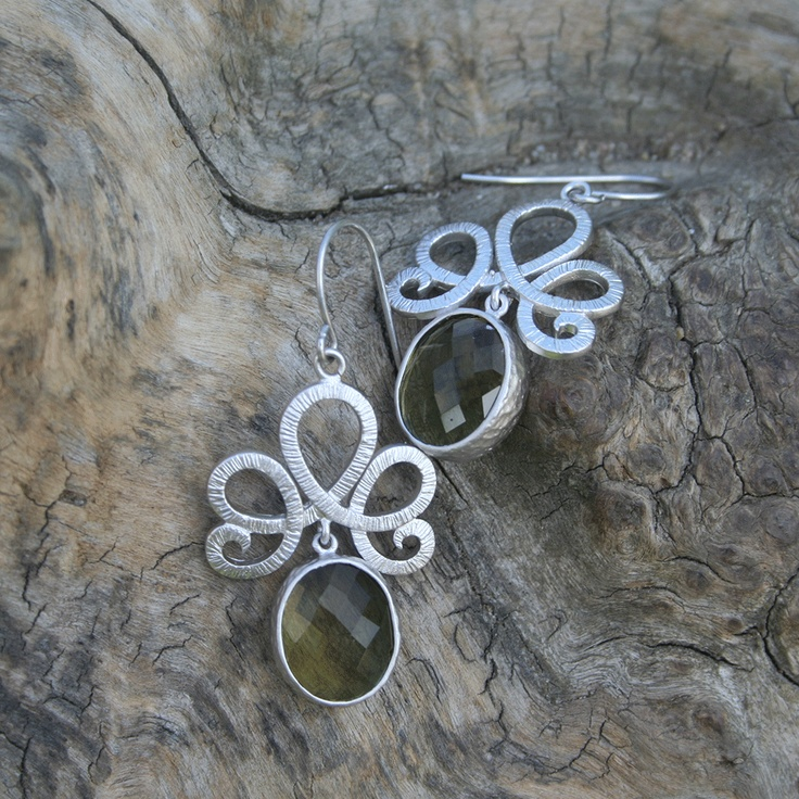 Earrings. Stylish and classical. Rhodium fan finding with dark green stone.