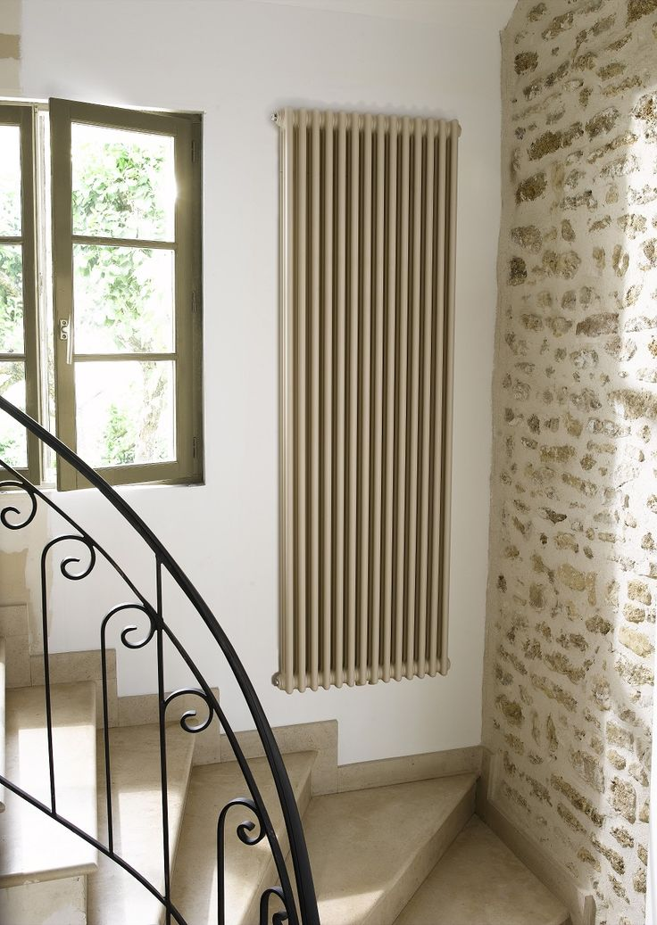Vertical column radiators - we don't waste space in our house.  The sequel.