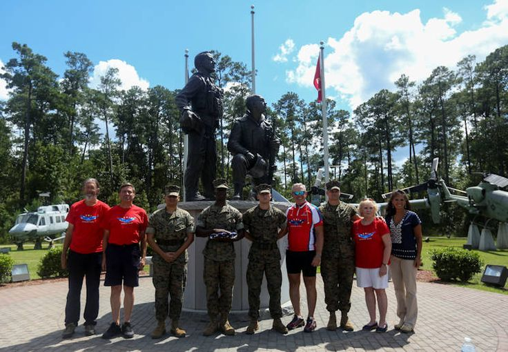 Retired Air Force Col. Gary West took a break from his 2,500 mile bicycle Patriot Honor Ride from Lubec, Maine to Key West, Florida, to be a part of a special flag folding ceremony on Marine Corps Air Station New River honoring fallen service members.