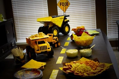 Construction Birthday Party Idea: black table cloth and yellow streamer=road!