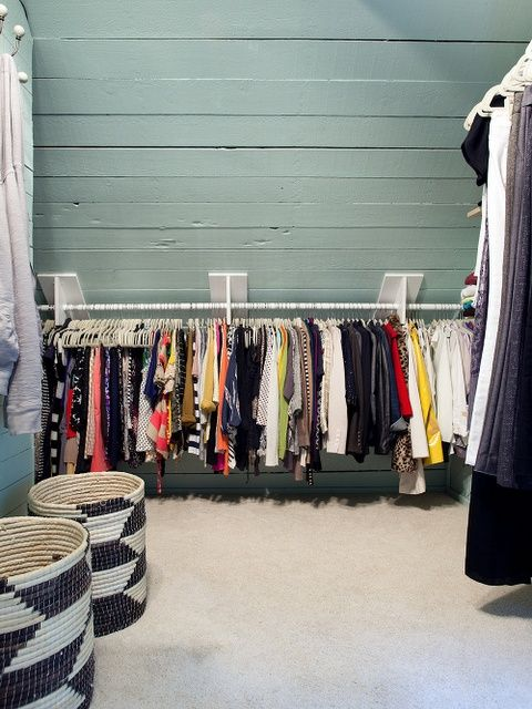 Attic storage – interesting technique for mounting clothing rails on the angled wall/ceiling