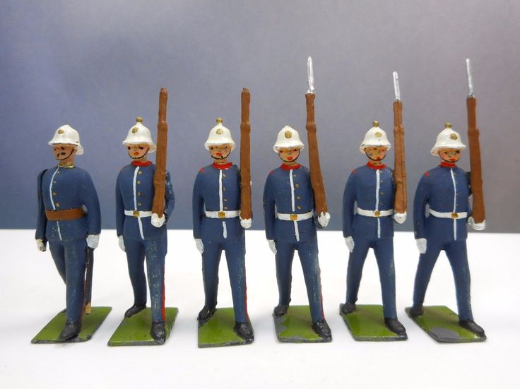 """""""6 Unusually matte finished Royal Marines. In great shape except for two bayonets missing. Paint is not newer and these may be from the Paris office who did not always conform to Britains guidelines for painting. I believe they are from set 1284 The bases state: (Hard to see in photos) BRITAINS LTD PROPRIETORS DEPOSE COPYRIGHT""""  Paris Office production ended before the 1920s.  That body was only used from 1938 for Royal Marines.  Set 1284 was first issued in 1933."""
