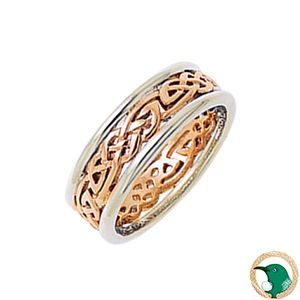 Serenity Ladies Celtic ring.  Style pictured our 18ct gold Celtic ring featuring a traditional flowing rose gold Celitc weave and sits between two white gold rails. 6.2mm width.   Clear and calm defines the emotion portrayed by this ring.