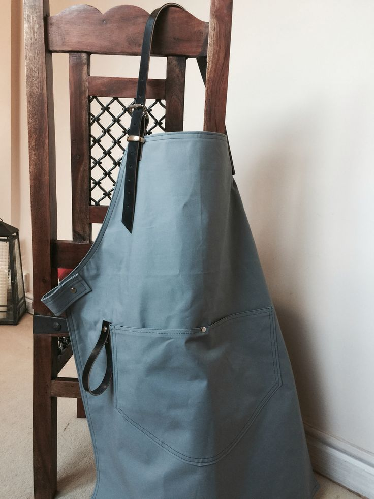 Slate grey 'Duck Canvas' aprons with nickel metal work and black leather strapping. For a client in street food.