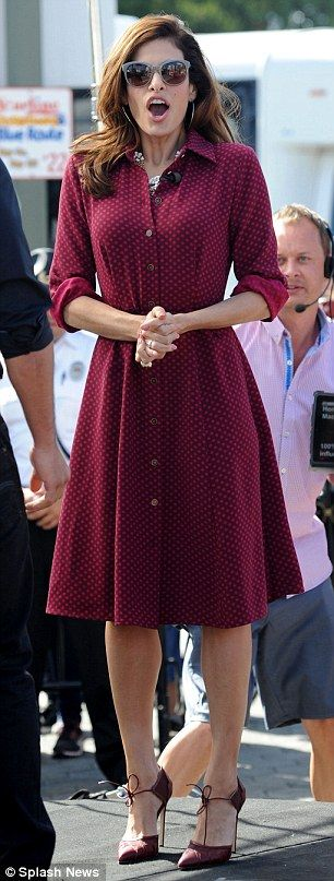 Eva Mendes wore a polka-dot shirt dress (from her collection with New York & Company), a rose adorned gold-chain necklace and burgundy looked Bionda Castana heels.