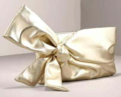 Love this valentino golden bow clutch to carry with your traditional outfits?
