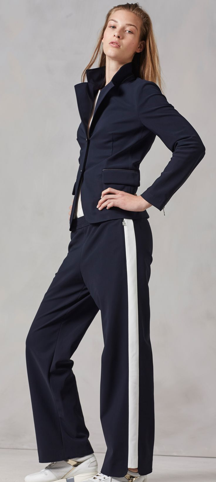 Office-chic has never looked this sporty – these track pants have the cut and elegant feel of classic slacks, but the comfort-level and mobility of athletic wear. The smart, slimming racing stripe down the side gives the wearer an extra sporty look that's sure to stand out.