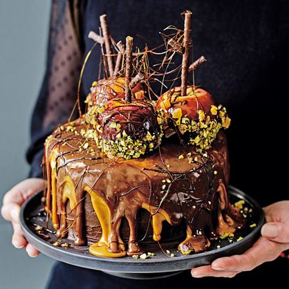 Sweet treats aren't just for trick or treaters! This showstopping cake dripping with layers of caramel and chocolate, and a centrepiece of sticky, sweet toffee apples, is wickedly irresistible.   Tesco