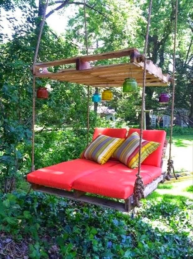 Boho Lounge Swing, with lanterns. Made out of pallets. This is pretty awesome!