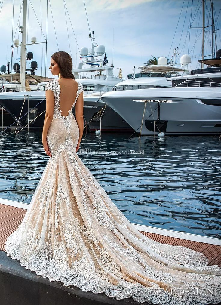 Vestido De Novia 2017 Lace Wedding Dresses Cap Sleeves Deep Plunging V Neck Ivory Color Sexy Elegant Fit And Flare Wedding Gowns Wedding Dress Style Wedding Dress With Lace From Gonewithwind, $502.52  Dhgate.Com