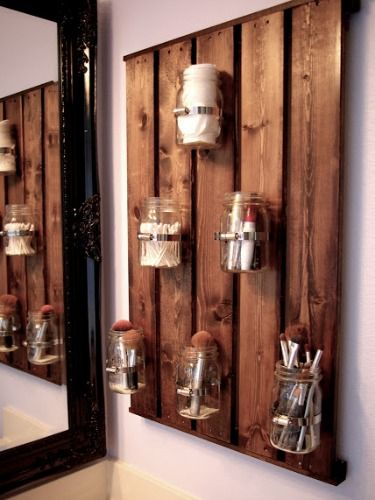 12 Sneaky Storage Tricks for a Tiny Bathroom - A rustic pallet is the perfect skinny surface on which to hang jars that house makeup tools. Plus, it acts as a design element first, storage second.