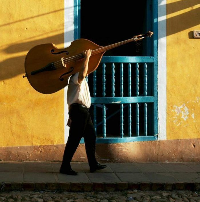 Atlanta-Latin-Jazz-Band-Samba Latin Jazz Bass Player carrying instrument on shoulder.
