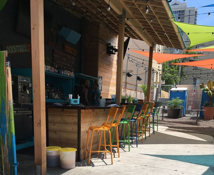 BFM seating Beachcomber chairs and barstools in this rustic outdoor restaurant design #wherespacedefinesdesign
