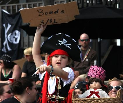 Future business leaders. Megan Celao, 6, and her sister Braden Herman, 11, sold beads from a home on the Gasparilla parade route.