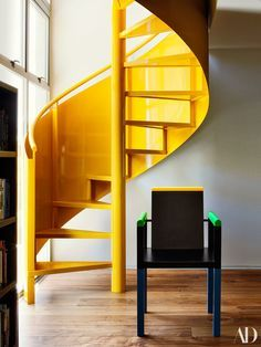 """""""People know they're 'the people with the yellow staircase,'"""" Richard says of his clients Sharon Oreck and Bill Pope. Yellow Stairs, French Interior, Interior Design, Walnut Floors, Ceiling Installation, Wide Plank Flooring, Post And Beam, Los Angeles Homes, House On A Hill"""
