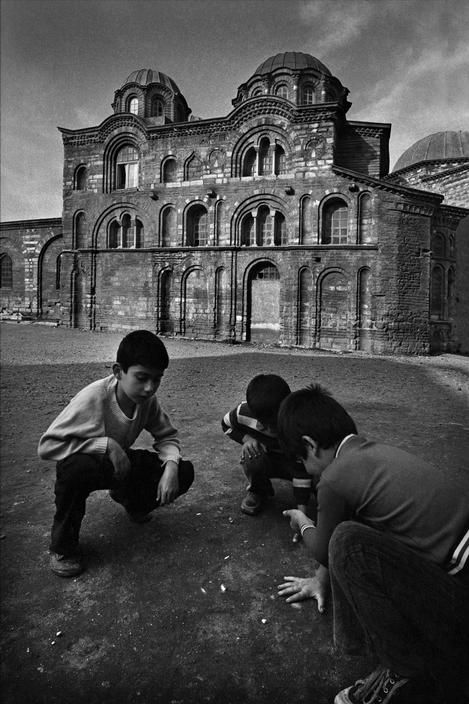 Boys playing marbles in the courtyard of the Fethiye Mosque in Istanbul, photo by Ara Güler (please repin with photographers credits)