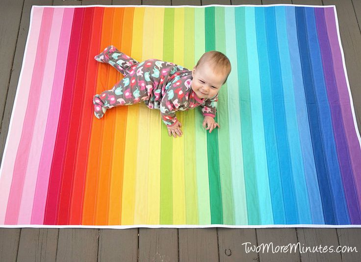 Easy Rainbow Quilt from a Jelly Roll - Perfect beginner quilt from Two More Minutes.