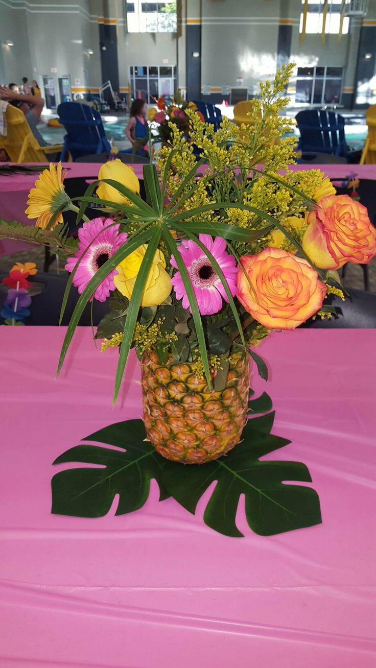 I made these pineapple flower centerpieces for my daughters luau pool party