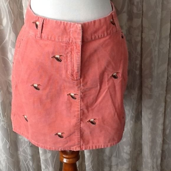J.Crew coral skirt with duck motif J.Crew coral corduroy skirt with embroidered flying ducks. Slit front and back pockets. 16 inches long. 100% cotton. J. Crew Skirts
