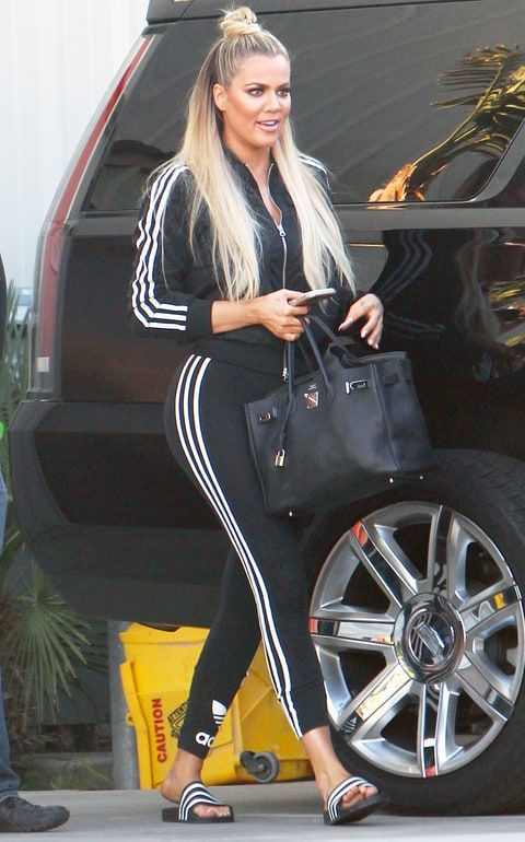 Khloe Kardashian wore head to two Adidas including the Adilette Ultra Slides. Find and shop slip-on sandals here!