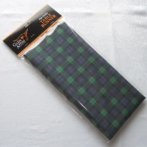 Black Watch tartan paper table runner  Size: 400cm x 32.5cm (approx. 13.1 ft  x 13ins)  Made from  non-woven 1 ply airlaid tissue which feels like fabric and does not crease.  Ideal for a dinner party, banquet, Burns Night Supper, etc.