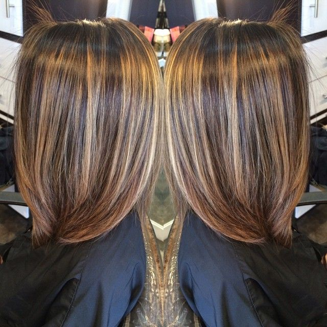 All over brunette to a dimensional goddess  color and cut done by Kris Cantwell…