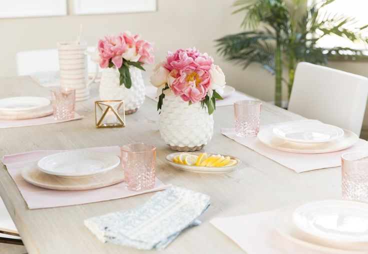 Christine lists fresh flowers and neutral dinnerware that can be mixed and matched as her dinner party must...