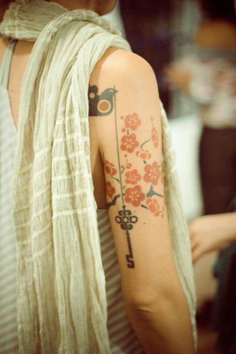 Generally not a big fan of flower tattoos, but the bird and key here are awesome