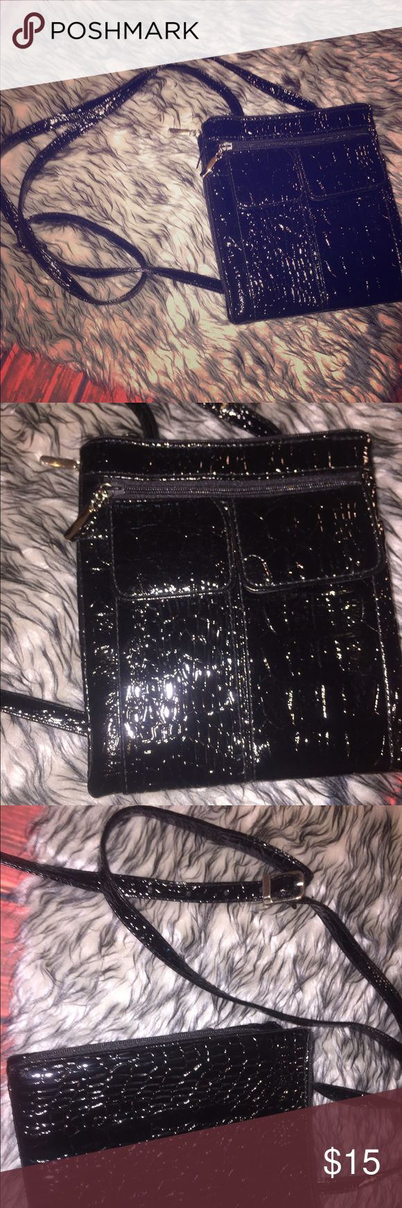 Small cross body Snakeskin printed patent leather purse, good used condition. Really cute and dainty, with TONS of pockets and three different zip up storage areas. Great for traveling, couponing, errands, festivals or movie nights! Bags Crossbody Bags