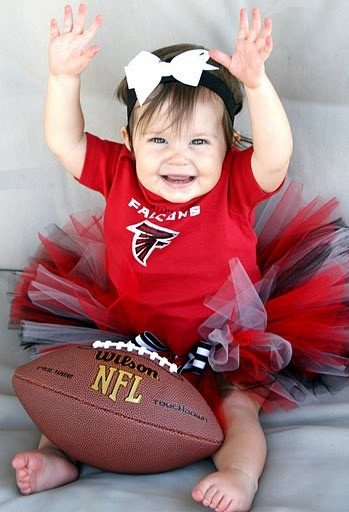 awwww this will be my daughter only scrap the Ravens shirt for a Husker one and the football from NFL to NCAA :D